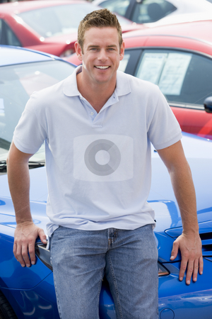 Man choosing new car stock photo, Man choosing new car on lot by Monkey Business Images