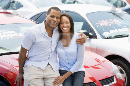 Couple looking at new cars stock photo, Couple looking at new cars on lot by Monkey Business Images