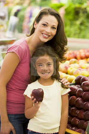 Mother and daughter shopping for fresh produce stock photo, Mother and daughter shopping for fresh produce in supermarket by Monkey Business Images