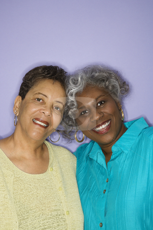 Women friends smiling. stock photo, Mature adult African American females smiling looking at viewer. by Iofoto Images