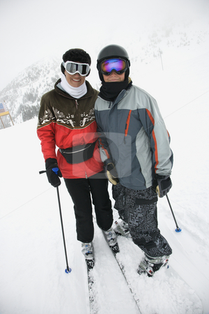 Mom and son at ski slope. stock photo, Middle-aged mother with teenage son on snowy ski slopes. by Iofoto Images