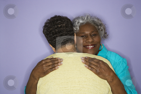Women embracing. stock photo, Mature adult African American females embracing. by Iofoto Images