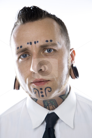 Adult male with tattoos and piercings. stock photo, Caucasian mid-adult man with tattoos and piercings wearing necktie. by Iofoto Images