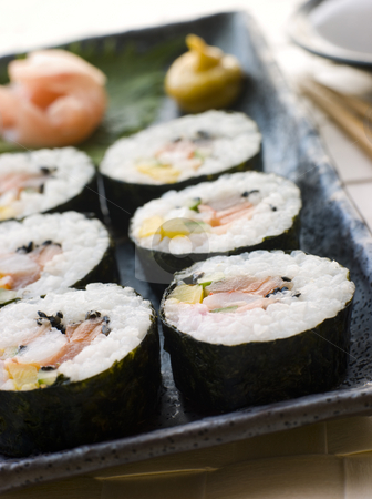 Large Spiral Rolled Sushi with Sushi Ginger Wasabi and Soy Sauce stock photo, Plate of Large Spiral Rolled Sushi with Sushi Ginger Wasabi and Soy Sauce garnish by Monkey Business Images