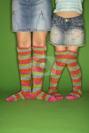 Multicolored socks on two girls stock photo, Caucasian female children wearing striped socks. by Iofoto Images