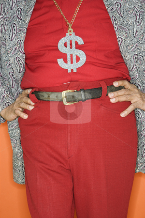 Man wearing money sign necklace. stock photo, Mature adult Caucasian male wearing money sign necklace. by Iofoto Images