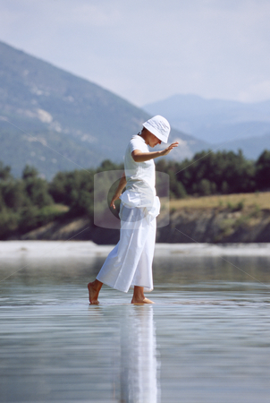 Young woman walking in lake stock photo,  by Monkey Business Images