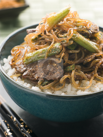 Sweet Soy Beef Fillet With Shirakaki Noodles on Rice with Shichi stock photo, Bowl of Sweet Soy Beef Fillet With Shirakaki Noodles on Rice with Sprinkled with Shichimi Togarashi Pepper by Monkey Business Images