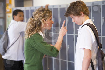 A teacher telling a student off stock photo,  by Monkey Business Images