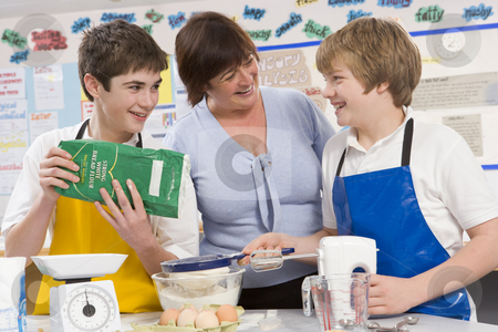 Schoolchildren and teacher at school in a cooking class stock photo,  by Monkey Business Images