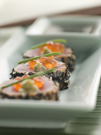 Seared Yellow Fin Tuna Rolled in Sesame seeds with Wasabi and Sa stock photo, Plate of Seared Yellow Fin Tuna Rolled in Sesame seeds decorated with Wasabi and Salmon Roe by Monkey Business Images