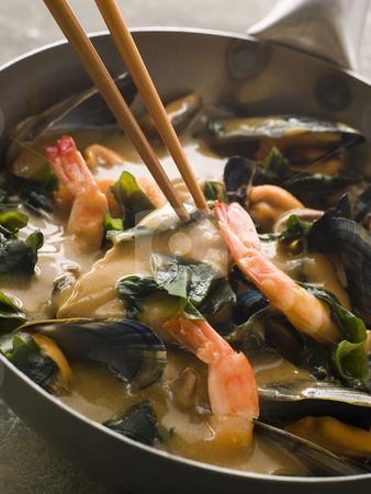 Japanese Seafood and Wakame Seaweed Curry stock photo, Pan of Japanese Seafood and Wakame Seaweed Curry with chopsticks being held by Monkey Business Images