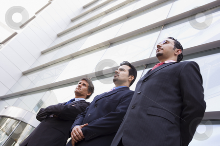 Group of businessmen outside office stock photo, Group of businessmen outside modern office building by Monkey Business Images