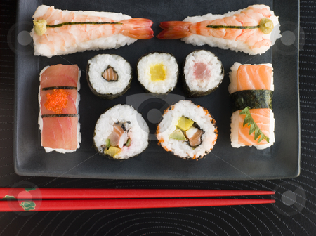 Selection of Seafood And Vegetable Sushi With Chopsticks stock photo, Overhead image of Selection of Seafood And Vegetable Sushi With Chopsticks by Monkey Business Images