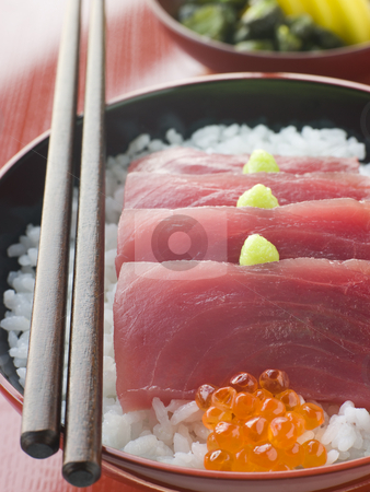 Sashimi of Yellow Fin Tuna on Rice with Salmon Roe Pickles and W stock photo, Bowl of Sashimi of Yellow Fin Tuna on Rice decorated with Salmon Roe Pickles and Wasabi by Monkey Business Images