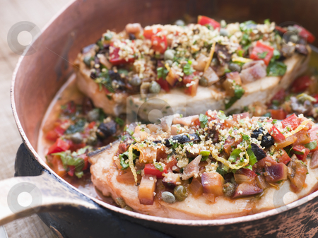 Baked Sicilian Swordfish in a Copper pan stock photo, Close up of Baked Sicilian Swordfish in a Copper pan by Monkey Business Images