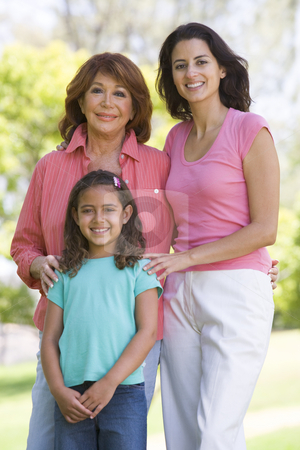 Grandmother with adult daughter and grandchild in park stock photo,  by Monkey Business Images