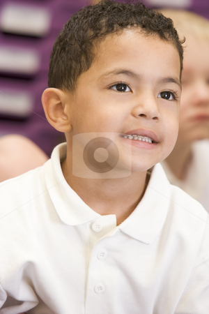 Schoolboy sitting in primary class
