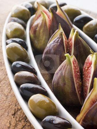 Dish of Green and Black Olives with Fresh Figs