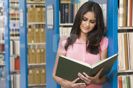 University student in library stock photo, University student studying book in library by Monkey Business Images