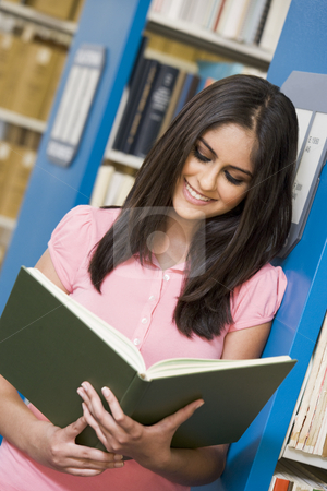 University student in library stock photo, University library studying book in library by Monkey Business Images