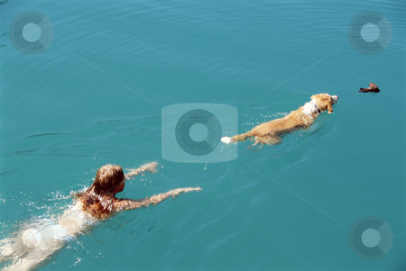 Young woman swimming with dog,  stock photo,  by Monkey Business Images
