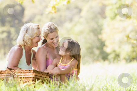 Grandmother with adult daughter and grandchild on picnic stock photo,  by Monkey Business Images