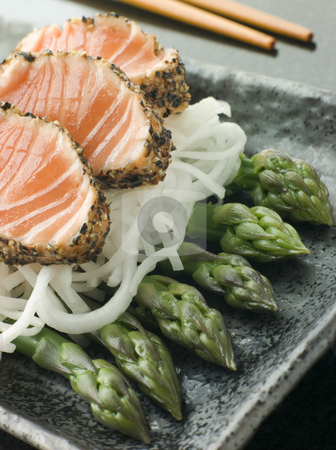 Seared Salmon Sashimi Black Pepper with a Mouli and Asparagus Sa stock photo, Plate of Seared Salmon Sashimi coated in Black Pepper with a Mouli and Asparagus Salad by Monkey Business Images