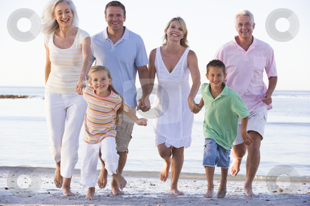 Extended family walking on beach stock photo,  by Monkey Business Images