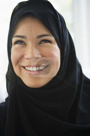 Portrait of a middle eastern woman wearing a black hijab