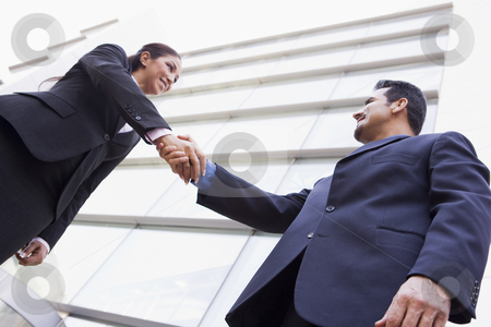Business people shaking hands outside office stock photo, Business people shaking hands outside modern office by Monkey Business Images