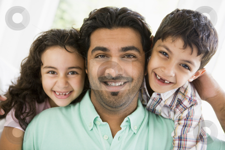 A Middle Eastern man with his children stock photo,  by Monkey Business Images