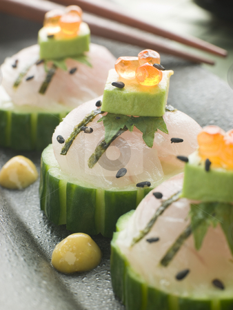 Sashimi Of Sea bass with Avocado and Salmon Roe stock photo, Dish of Sashimi Of Sea bass with Avocado and Salmon Roe with chopsticks by Monkey Business Images