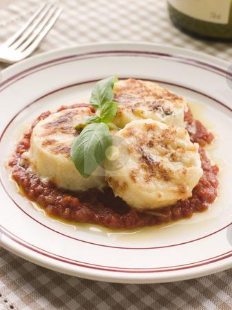 Gnocchi Romana with Tomato Sauce stock photo, Plate of Gnocchi Romana with Tomato Sauce by Monkey Business Images