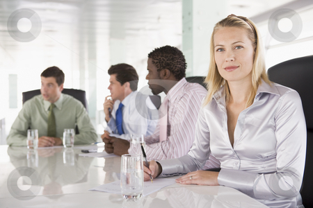 Four businesspeople in a boardroom stock photo,  by Monkey Business Images
