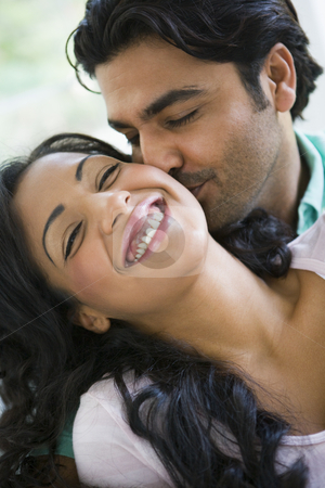 A Middle Eastern couple cuddling stock photo,  by Monkey Business Images