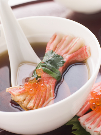 Clear Soup with Snow Crab Sticks stock photo, Bowl of Clear Soup with Snow Crab Sticks and Fish Roe decoration by Monkey Business Images