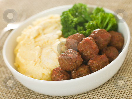 Tomato Meatballs with Parmesan Polenta and Broccoli stock photo,  by Monkey Business Images