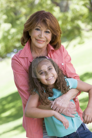 Grandmother and granddaughter smiling stock photo,  by Monkey Business Images