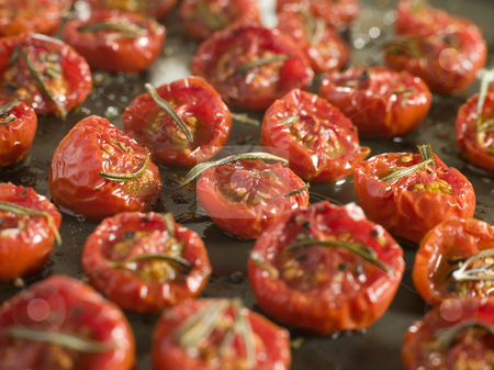 Tray of Oven Dried Tomatoes stock photo,  by Monkey Business Images