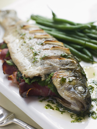 Whole River Trout with Jamon and Herb Butter stock photo,  by Monkey Business Images