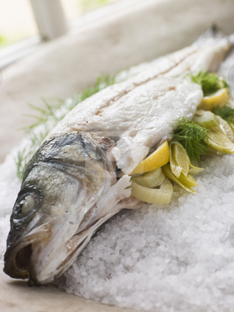 Whole Seabass Roasted in a Sea Salt Crust with Fennel stock photo,  by Monkey Business Images
