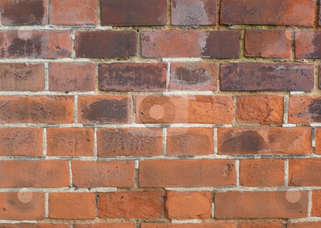 Red brick wall stock photo, Old fashioned type red brick wall showing the sign of age by Michael Travers