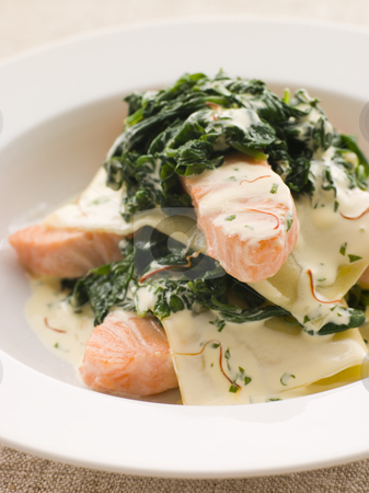 Open Lasagne of Salmon and Spinach with a Saffron Cream stock photo, Bowl of Open Lasagne of Salmon and Spinach with a Saffron Cream by Monkey Business Images