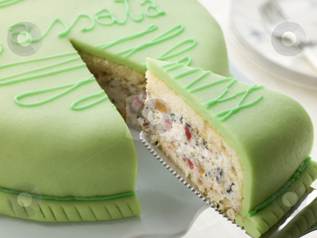 Slice of Cassata Cake stock photo, Cassata cake with slice being removed by Monkey Business Images