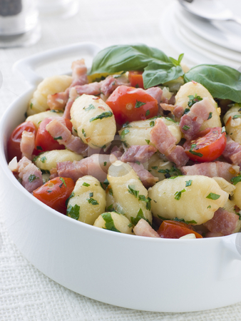 Bowl of Gnocchi with a Bacon Tomato and Basil Dressing stock photo,  by Monkey Business Images