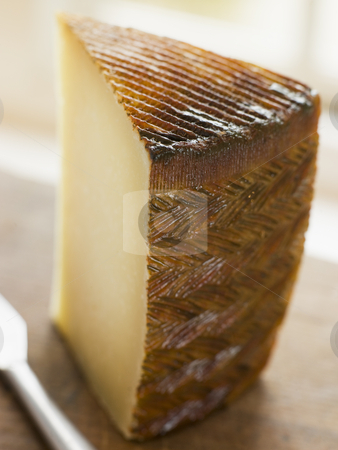 Wedge of Manchego Cheese stock photo,  by Monkey Business Images