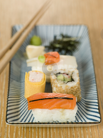 Plated Sushi with Wasabi Sushi Ginger and nori stock photo, Plated Sushi with Wasabi Sushi Ginger and nori with chopsticks by Monkey Business Images