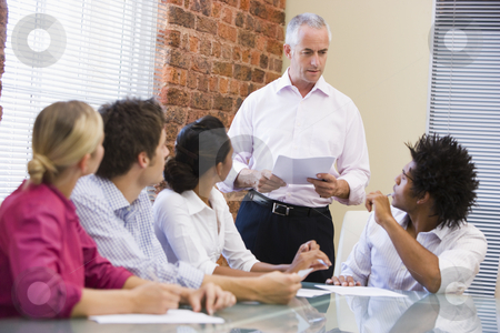 Five businesspeople in boardroom meeting stock photo,  by Monkey Business Images