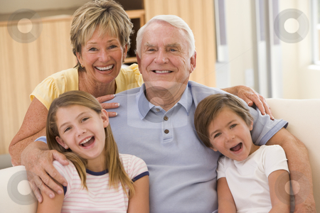 Grandparents posing with grandchildren stock photo,  by Monkey Business Images